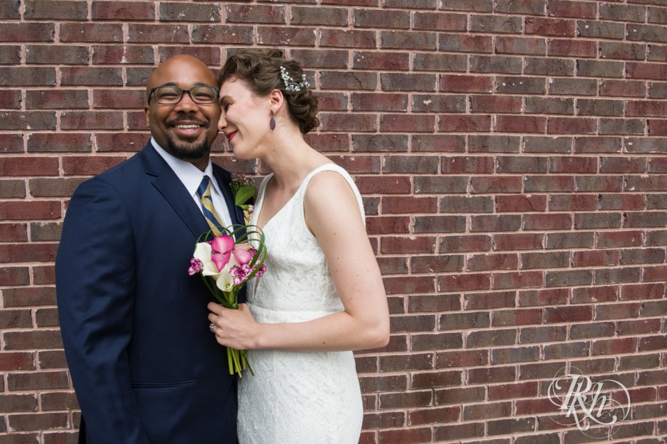 Biracial bride and groom laughing