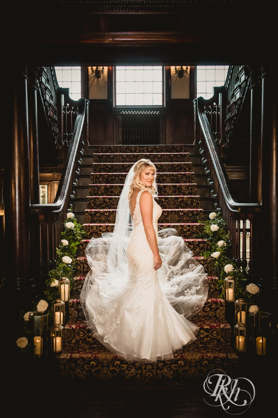 Beautiful bride on mansion steps