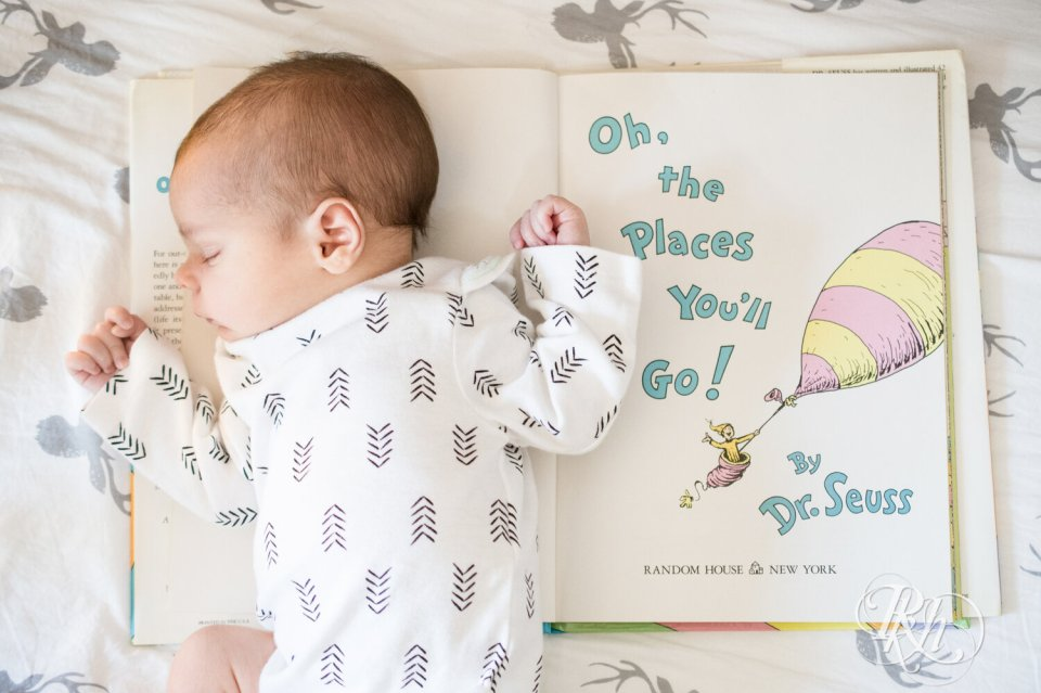 Baby lying on Dr. Seuss book