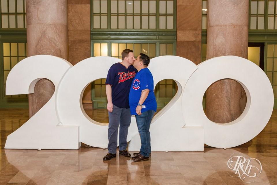 Men kissing at Union Depot at 2020 sign