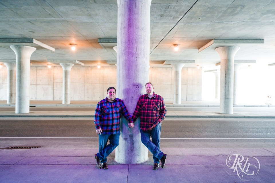 two men under bridge