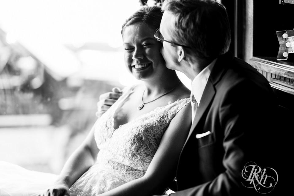 vow renewal groom kissing bride