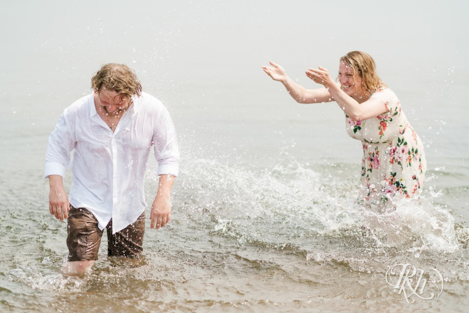 beach engagement session splash fight
