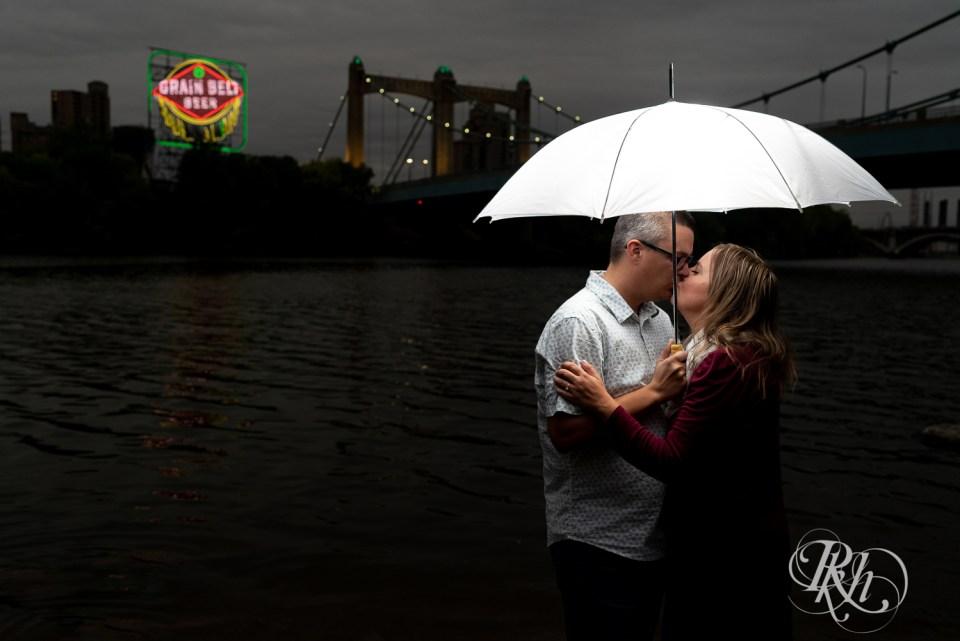 rainy engagement photos grain belt sign