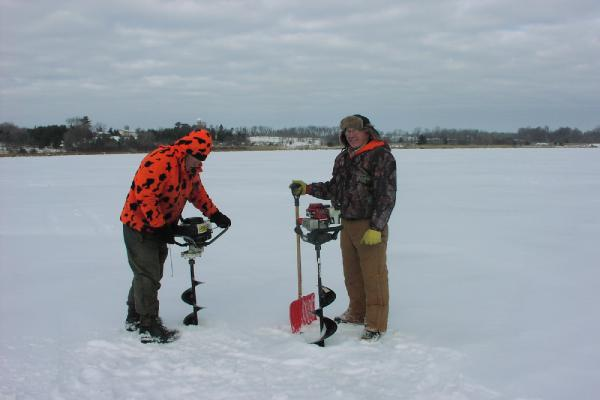 Stan Seidel and Larry Steeves used ice augers to drill through 21 inches of ice.