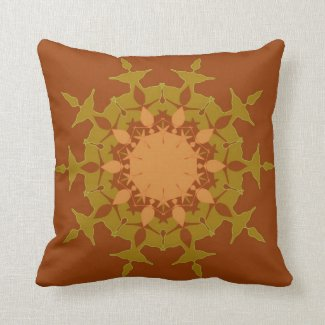 Artistic mandala on brown throw pillow