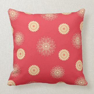 Beige flowers on dark orange pillows