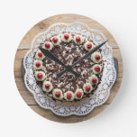 Black Forest cake on rustic wood Round Wall Clock