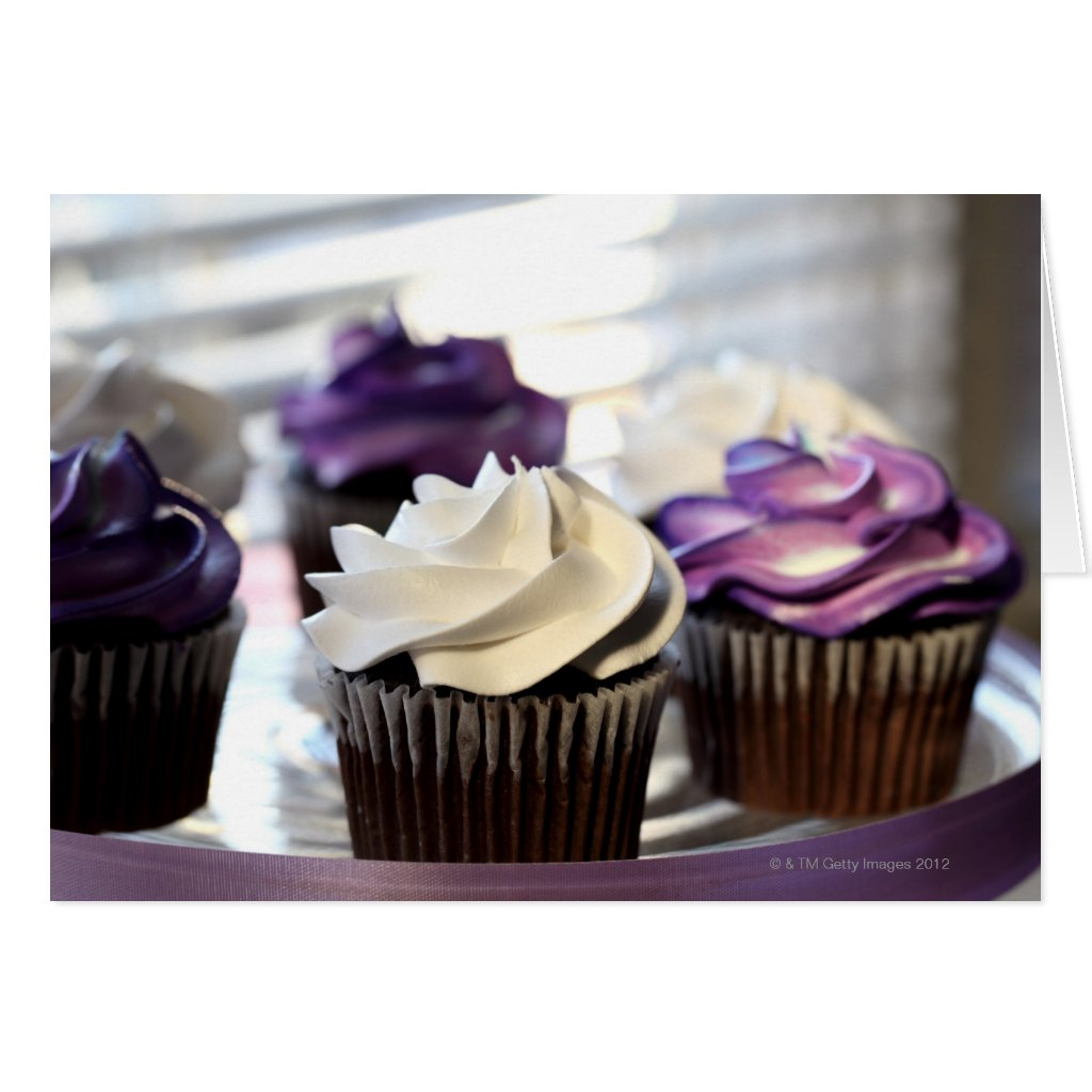 Close-up of cupcakes with selective focus on card