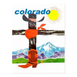 Colorado mountains, cowboy boots, scarf and hat postcard