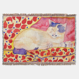 Colorful cat on a sofa blanket