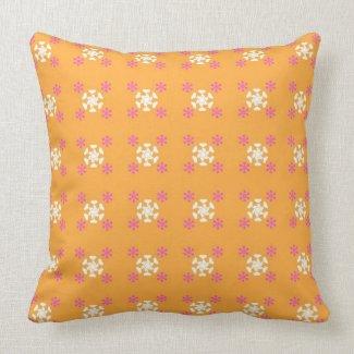 Floral pattern on orange throw pillow