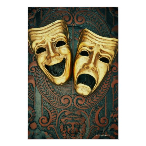 Golden comedy and tragedy masks on patterned print