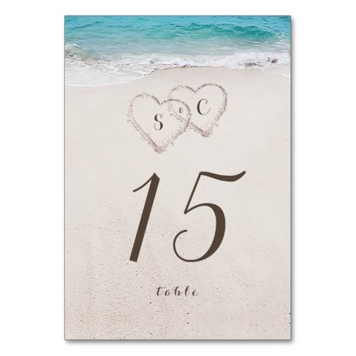 Hearts in the sand destination beach wedding table number