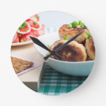 Homemade fried meatballs in a white bowl closeup round clock