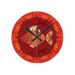 Ornamental fish on ethnic traditional flourish round clock