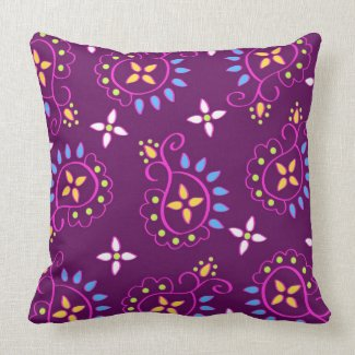 Paisley pattern on purple throw pillows