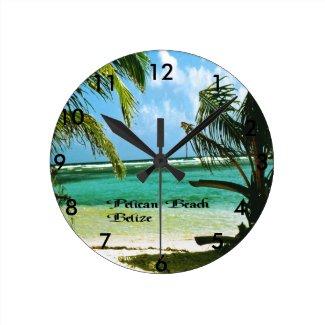 Pelican Beach Belize Round Wall Clocks