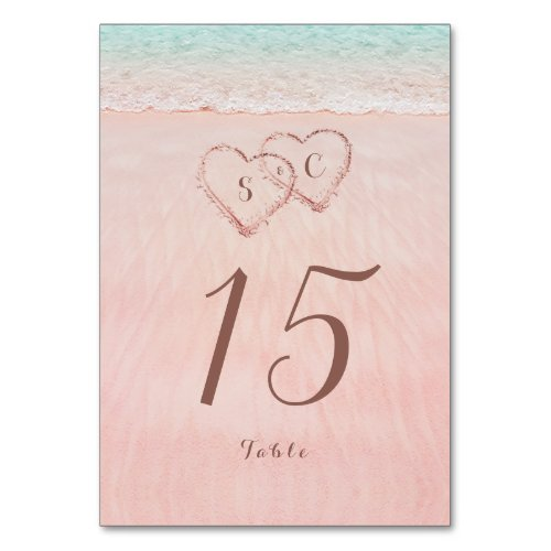 Pink hearts in the sand destination beach wedding table number