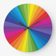 Rainbow Burst Round Clocks on Zazzle