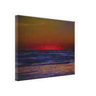 Red Sun Rising Over Troubled Seas Stretched Canvas Prints