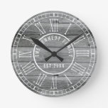 Rustic Gray Wood Family Name White Roman Numeral Round Clock
