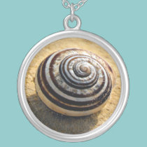 Snail Shell on Sand Pendant necklaces