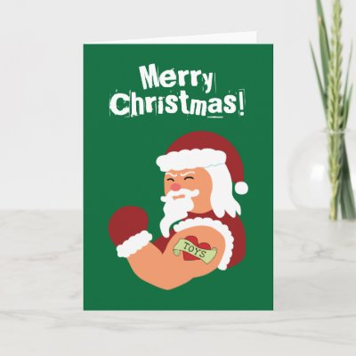 This funny holiday design features a tough santa with a heart tattoo on his