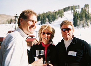 John Obourn, Robin Benko and Bruce Branson make a toast.