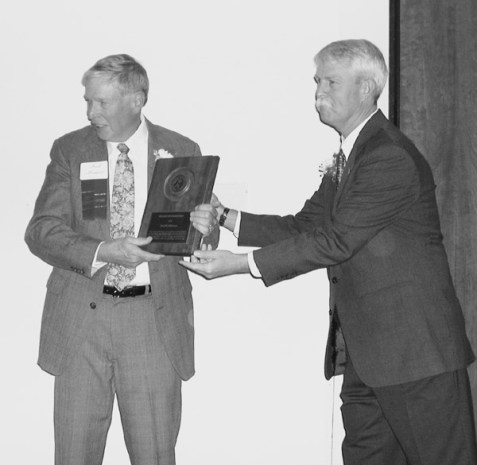 John Robinson presents Fred Meissner with an Honorary Membership Award.