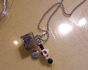 RMO Block guitar string/skull Necklace