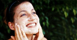 girl using face scrub for glowing skin