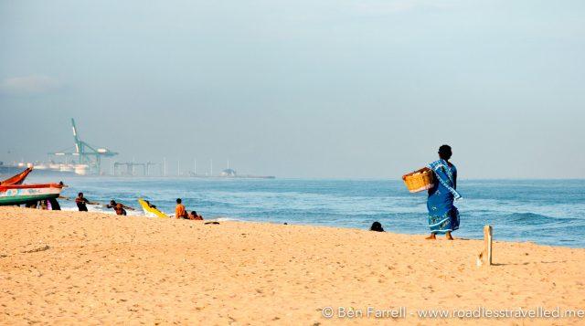A vendor sells her wares on Marine Beach. Chennai, India