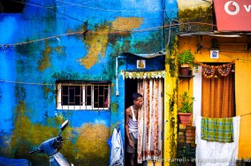 A local peeks out his door in Mumbai, India.