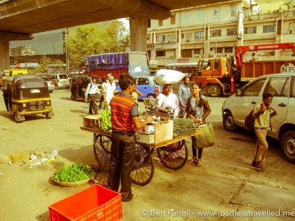 A Street Vendor sells his wares in the morning peakhour