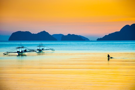 A fisherman bringing in his nets in El Nido, Philippines