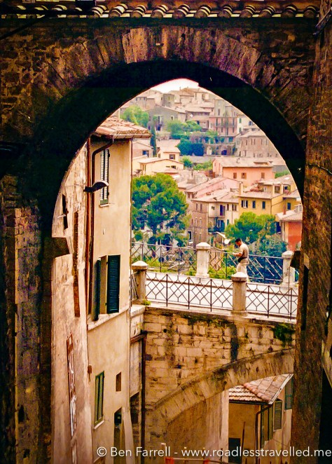 A local walks along one of the many ancient and scenic walkways the wrap around Perugia's 'Centro'.
