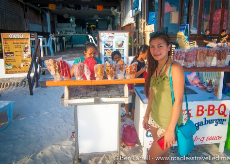 Buying BBQ from a beach vendor in Boracay