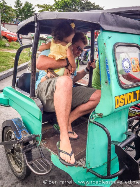 Trying to fit my awkward Western body into a local (small) Philippines 'trike' taxi with Lilly