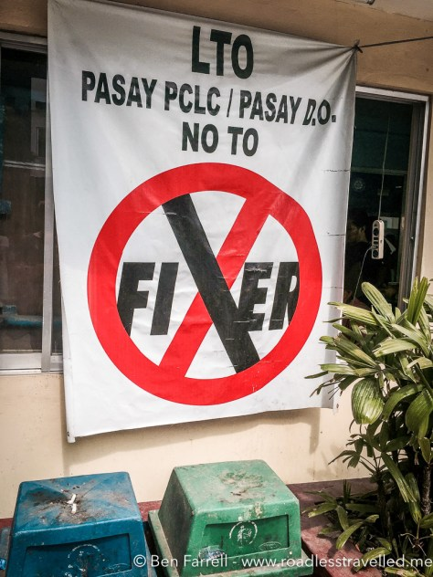The 'No Fixers' sign at the Land Transport Office (LTO) in Manila. Despite these signs everywhere, there's plenty of fixers to get the job done for you!