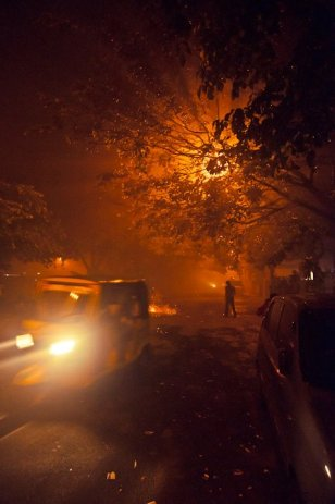 The streets of Chennai shrouded in smoke from the anual Divali festival