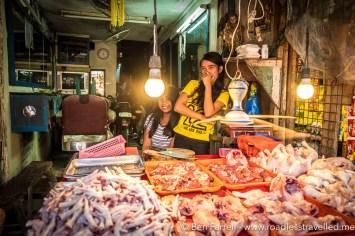 Shy vendors at a Manila wet market
