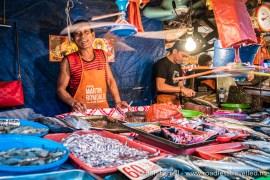 Smiling fish vendor, Manila, Philippines