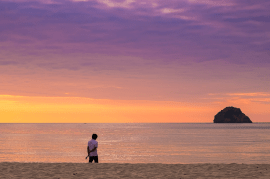 A sunset walk along the beach at Anawangin Cove, Philippines