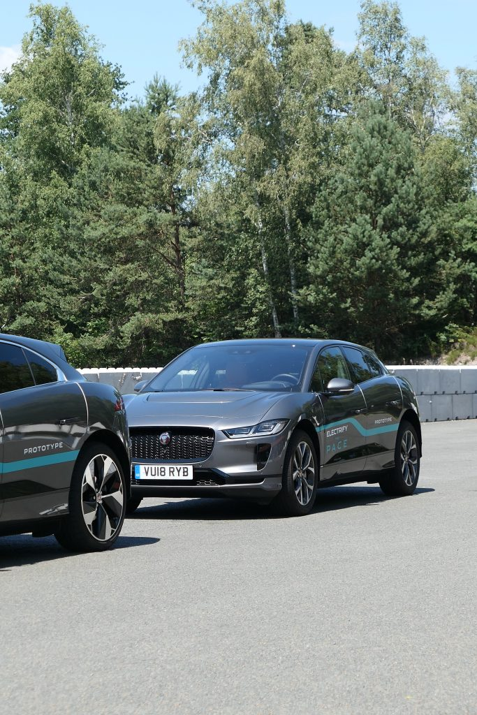 Two grey Jaguar I-Pace road rug cars roadrugcars brothers car voiture auto automobile vintage car super car hyper car