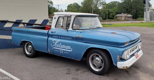 Scotsman truck in front of Scotsman woodshop Scotsman