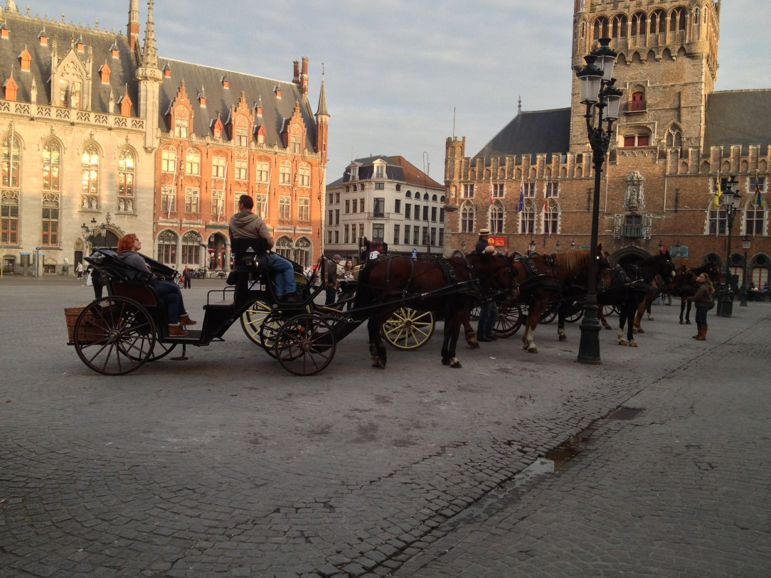 Horses for hire with carriages in the centre of Bruges