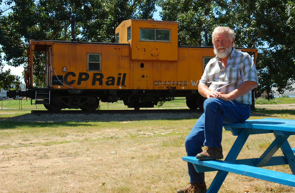 Darcy Harmacy and his caboose in Brooks, Alberta