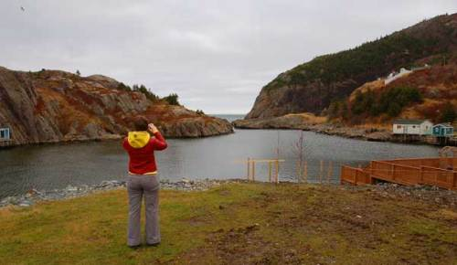 Woman photographing Quidi Vidi