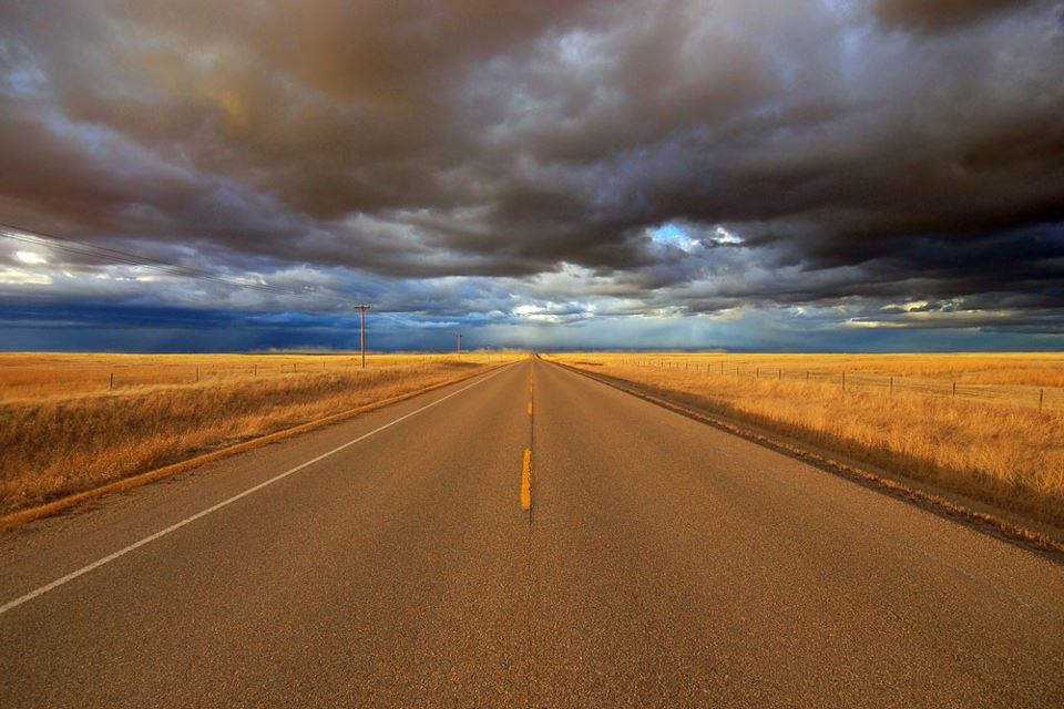 open road with golden fields
